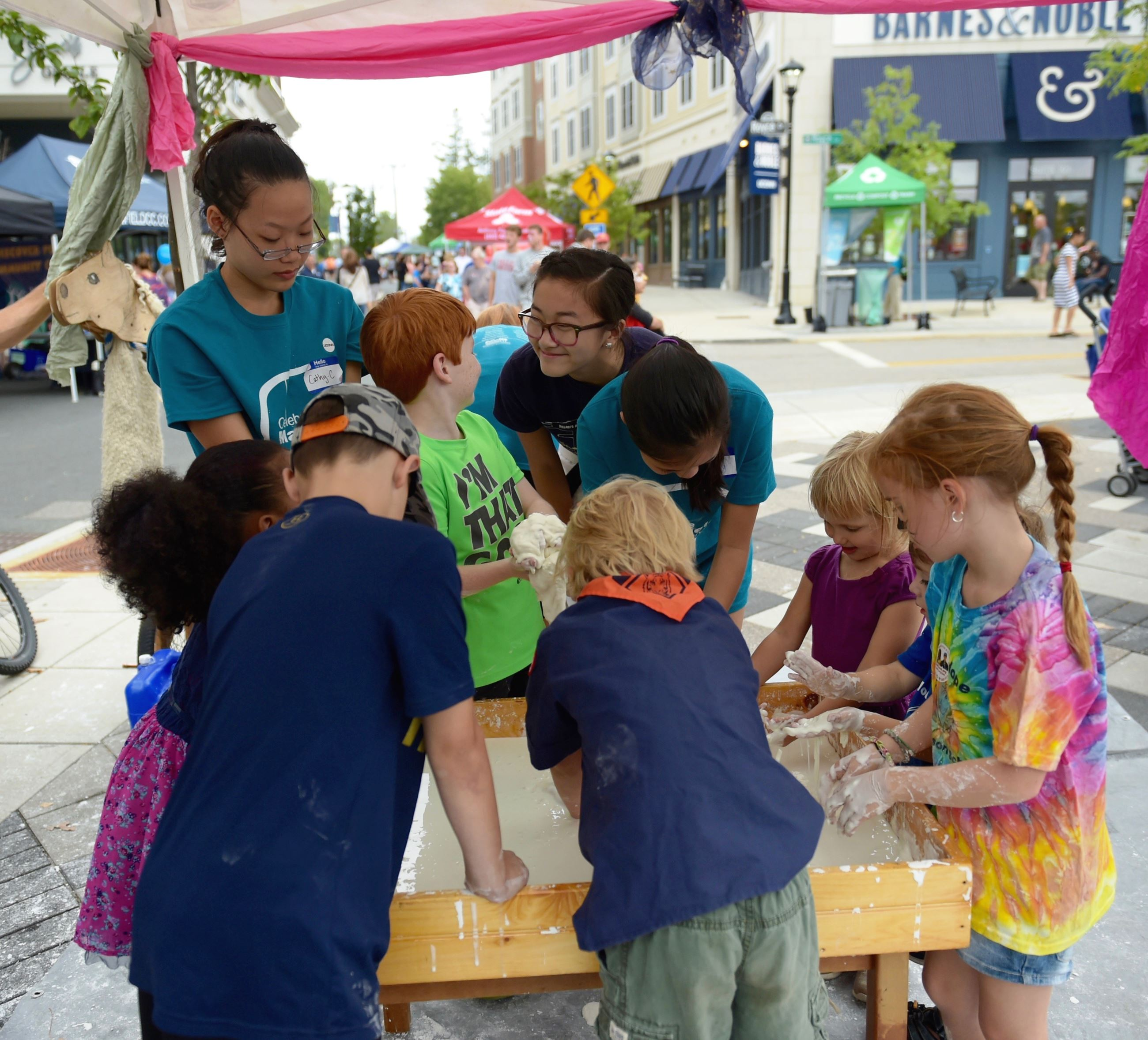 Children play at the Celebrate Mansfield Festival in Downtown Storrs