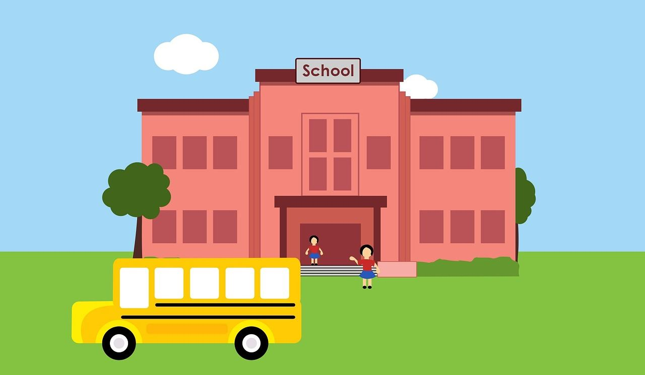 clipart image of school with school bus